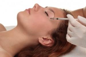 Woman receiving Botox treatment near the eyes