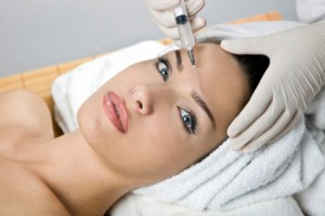 Beautiful woman receiving injectable treatment